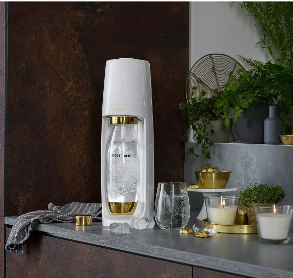 the white and gold sodastream on a decorated counter