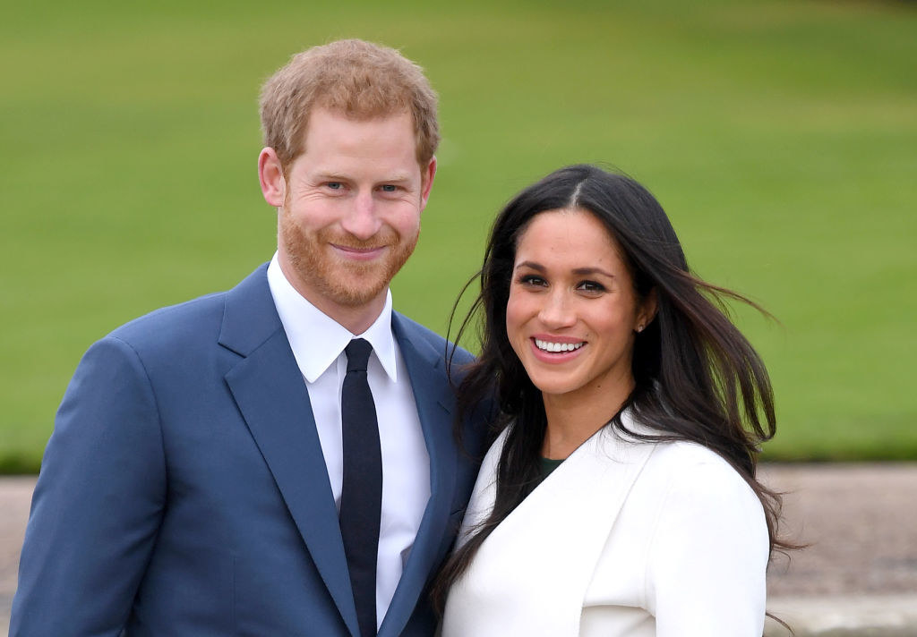 Prince Harry and Meghan posing for photographers after announcing their engagement