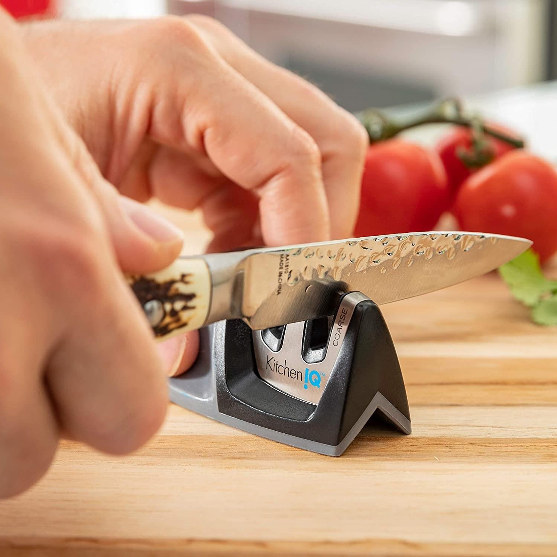 Person using a kitchenIQ small knife sharpener to sharpen knife