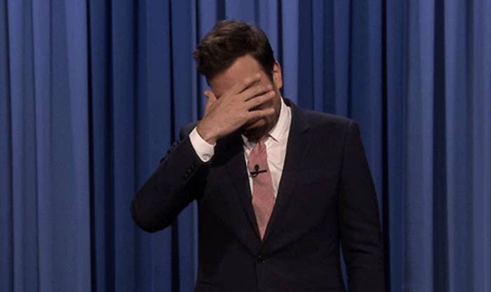 Cringing Jimmy Fallon covering his face