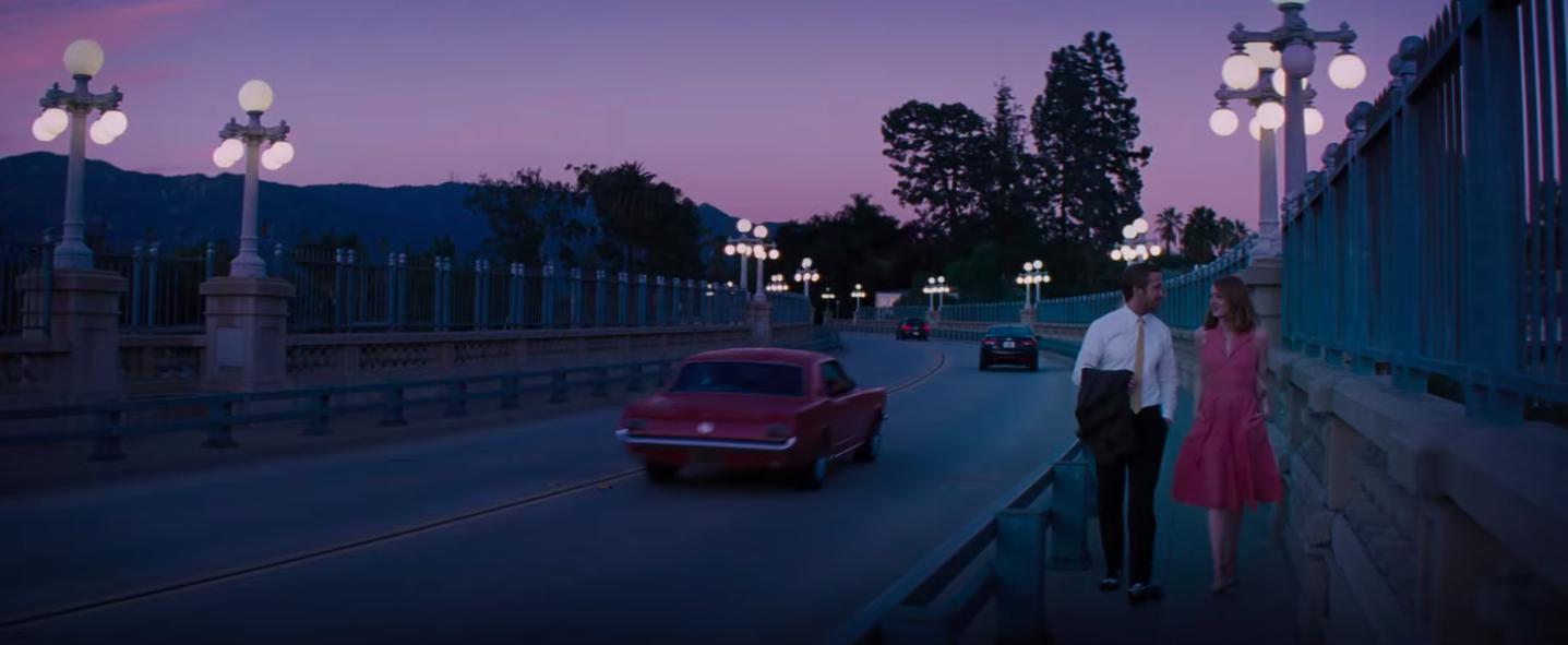"Sebastian and Mia from ""La La Land"" walking on a bridge"