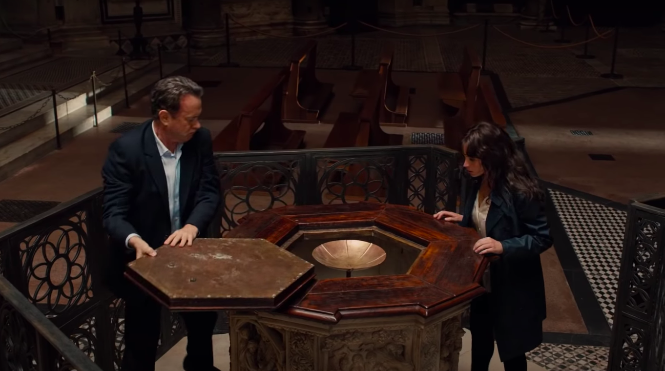 """Robert Langdon and Sienna Brooks inspecting something in a church in """"Inferno"""""""