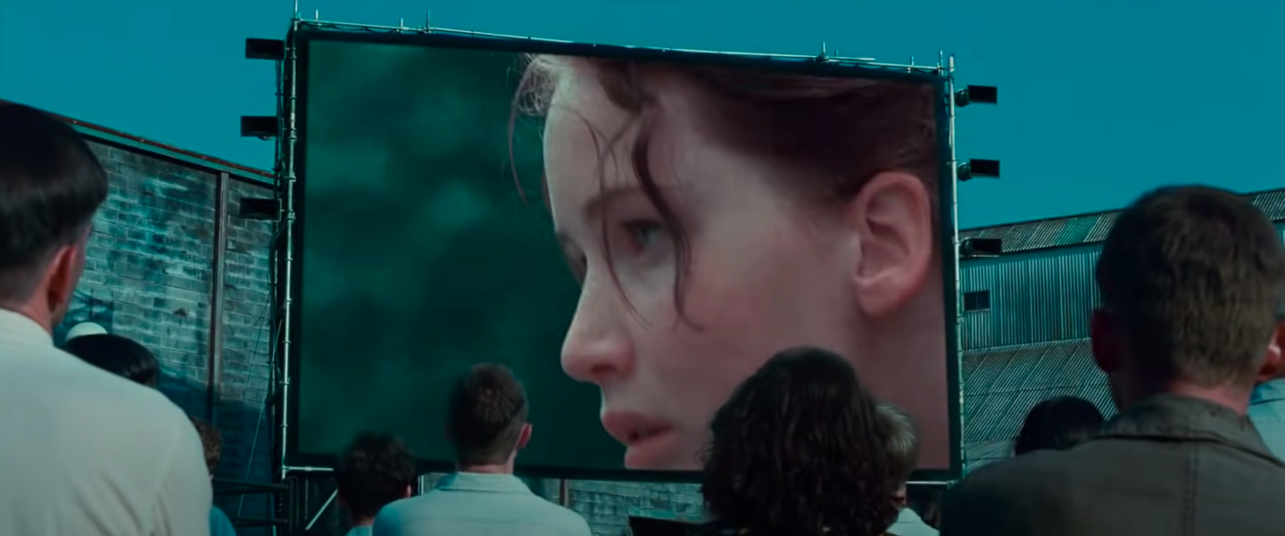 """Katniss on the screen in District 12 in """"The Hunger Games"""""""