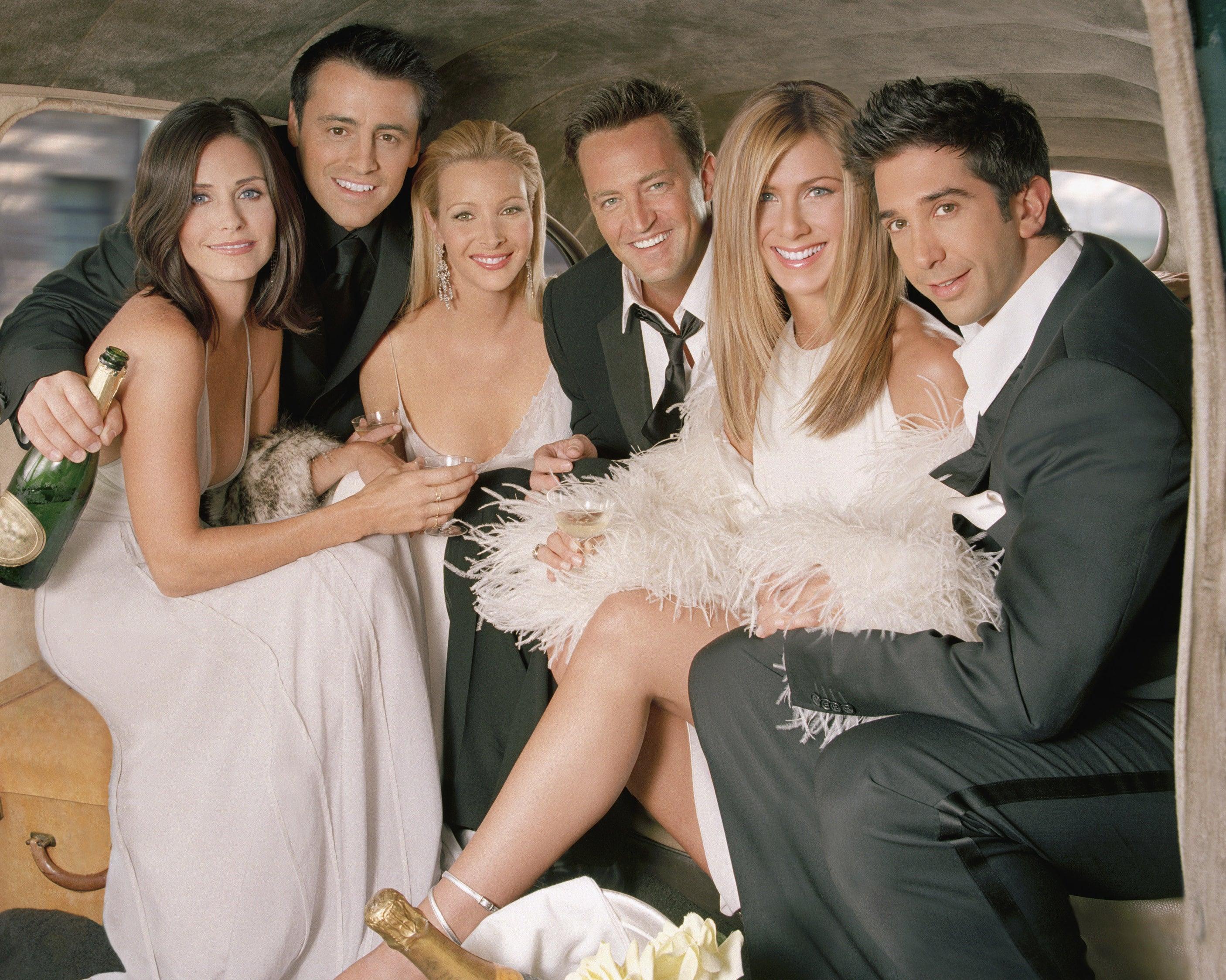 The Friends cast sit in a limo in formal wear