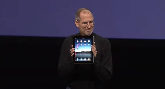 Steve Jobs holds up the very first iPad at the Apple release event in 2010