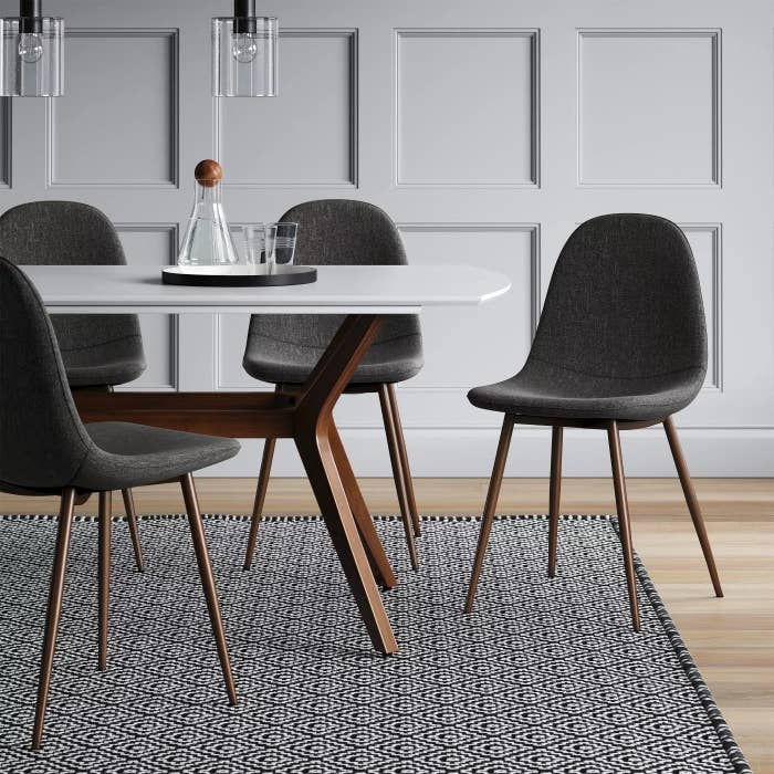 The upholstered chairs with wooden legs in a dining room
