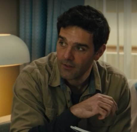 Dylan's father sits in his hospital room