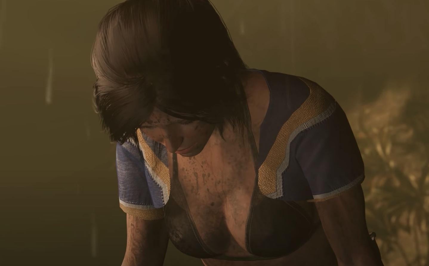 The main character from Tomb Raider bending down