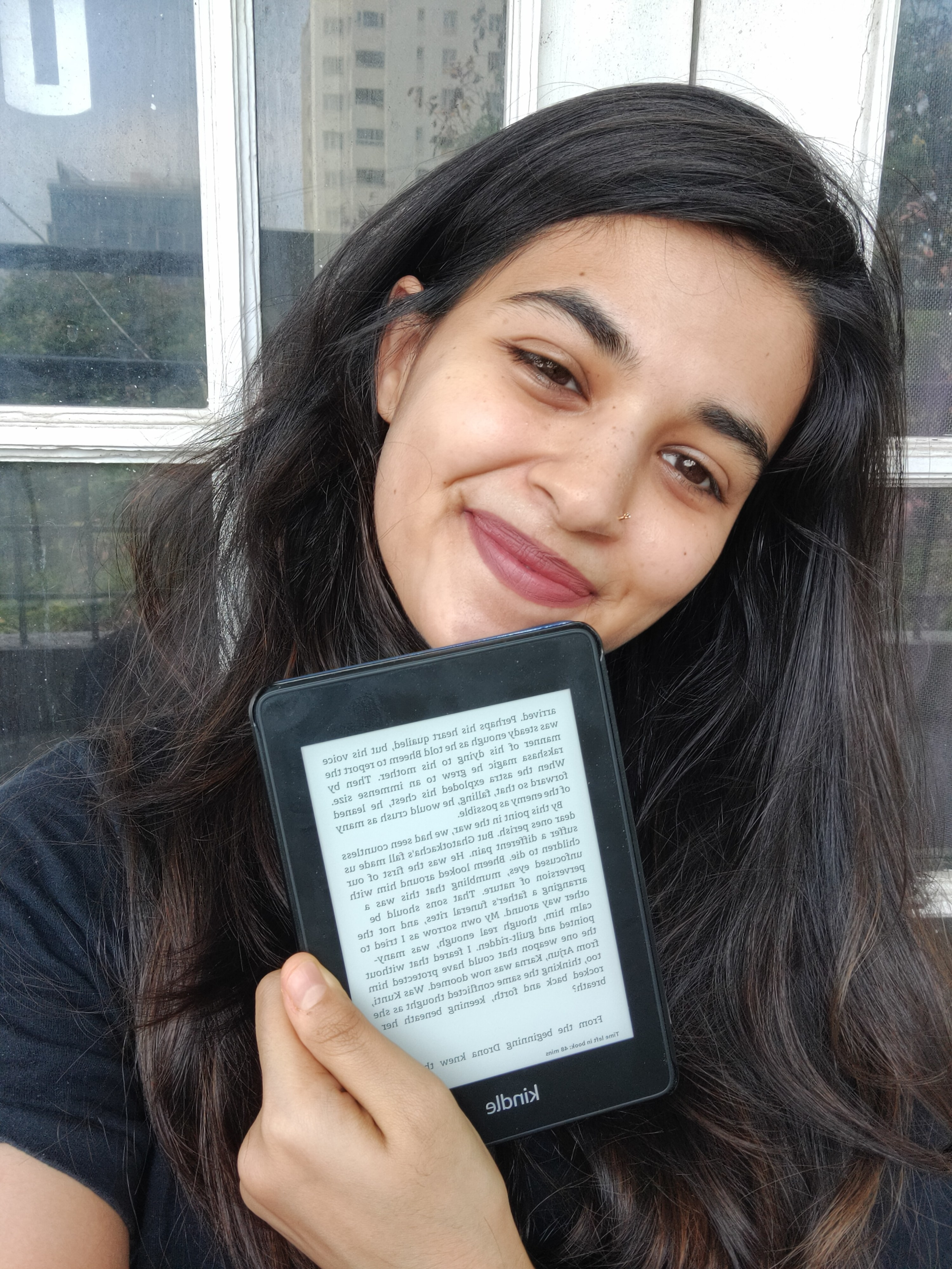 A photo of me holding the Kindle