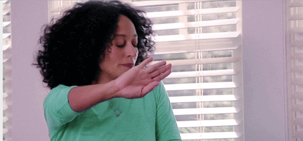 Tracee Ellis Ross extending her hand in front of her face in annoyance