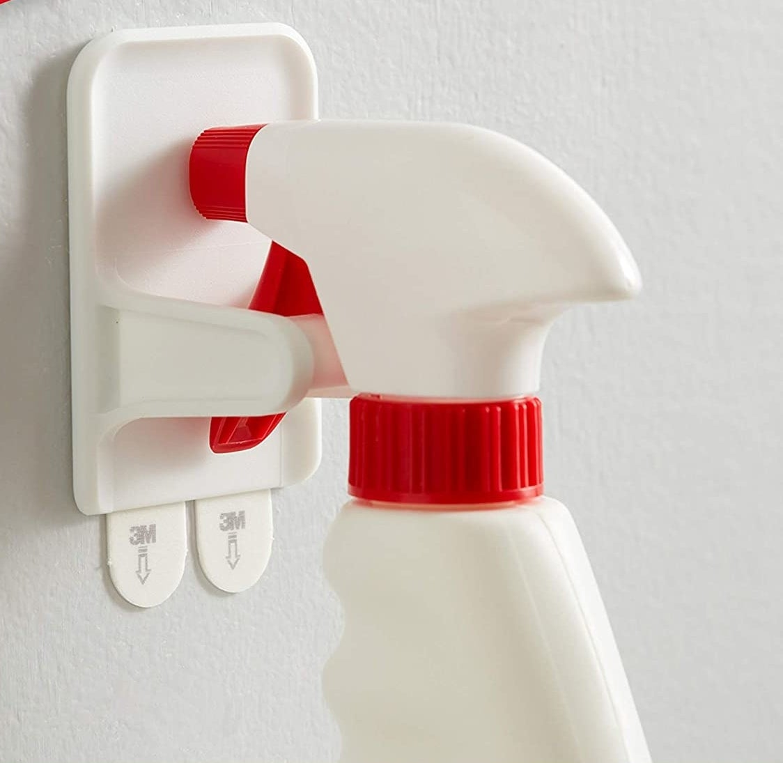 A spray bottle hanging securely from the spray bottle hanger
