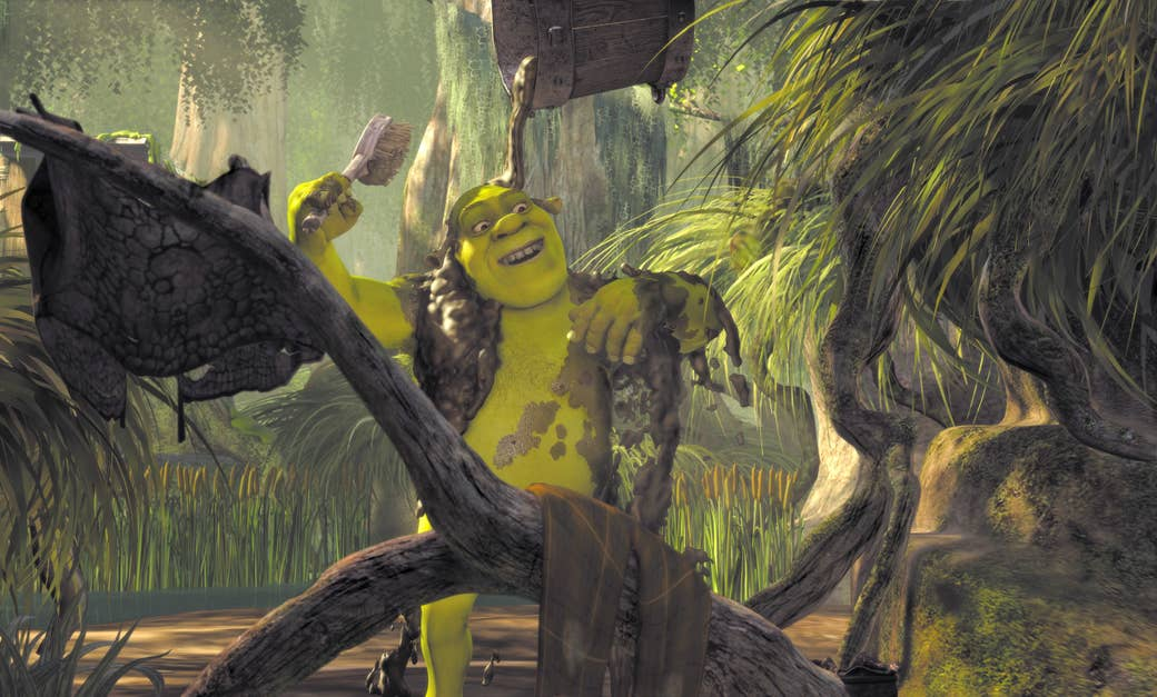 Shrek showers with a bucket of mud in a swamp