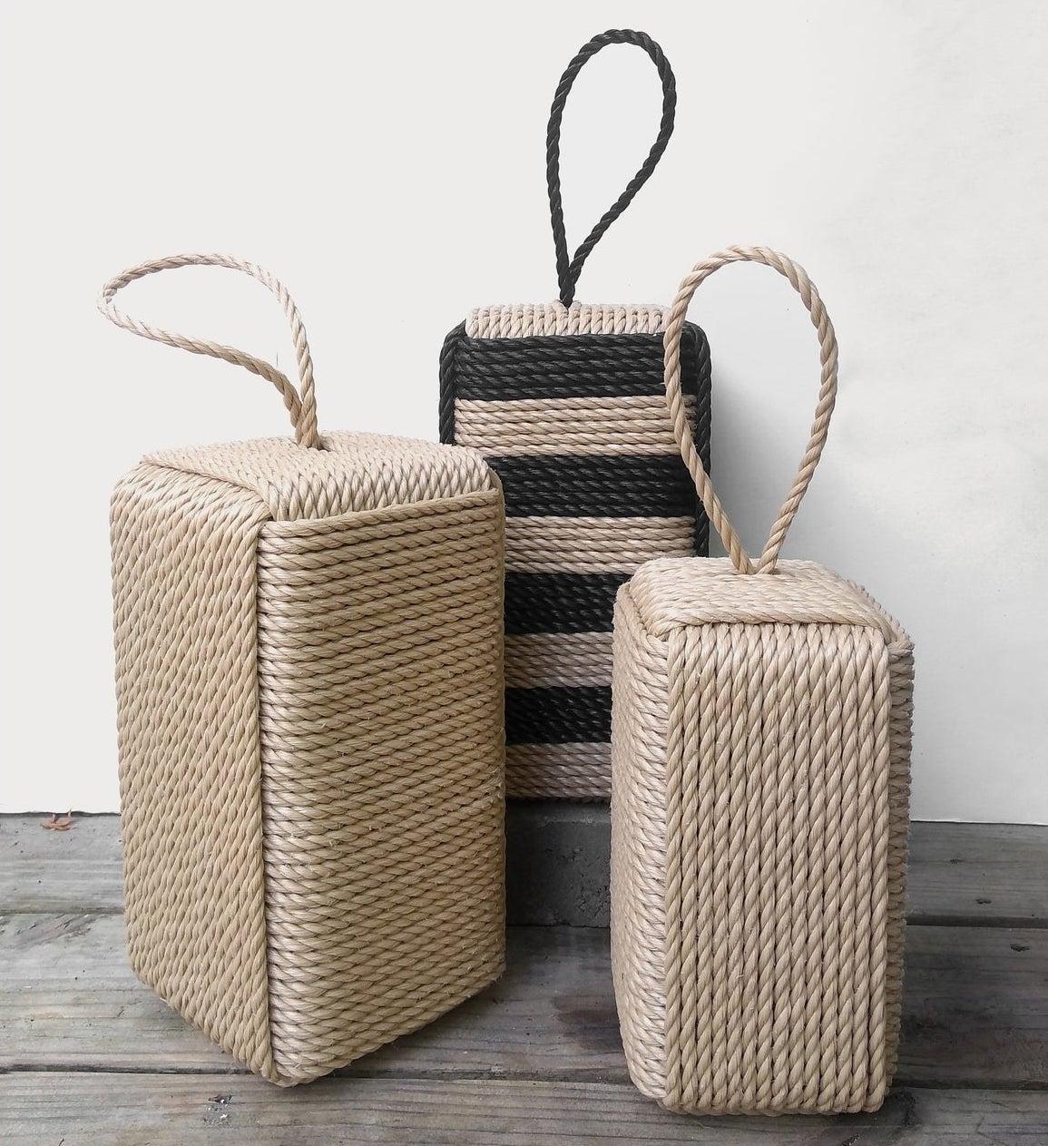 three rectangular doorstops with rope wrapped around them