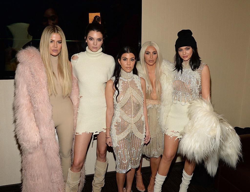 The Kardashian sisters posing for a photo