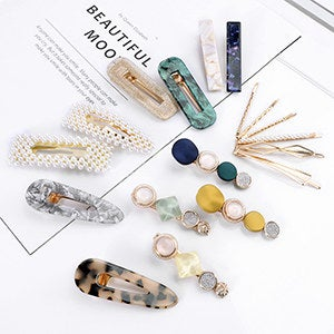 set of clips and pins including gold, pearl, acrylic tortoiseshell, and jeweled varieties