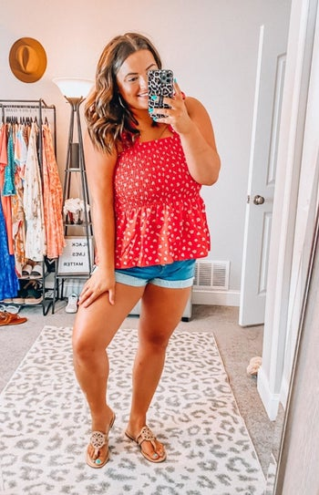 a reviewer wearing the top in red