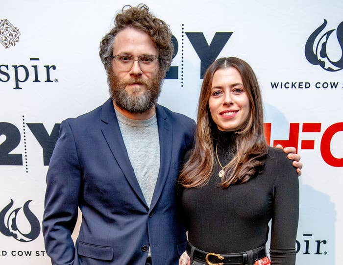Seth puts his arm around Lauren at an event