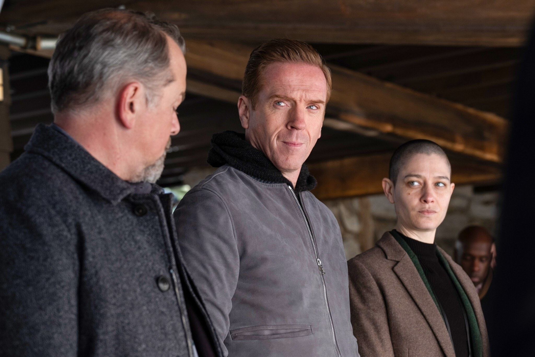 David Costabile, Damian Lewis, and Asia Kate Dillon look into the distance