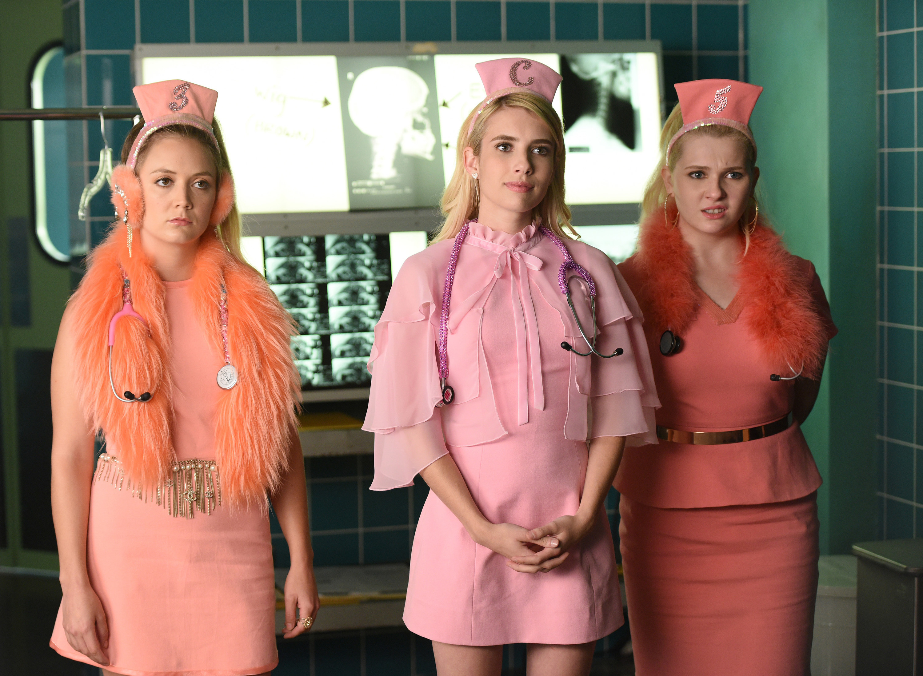 Billie Lourd, Emma Roberts, and Abigail Breslin wear pink doctors outfits