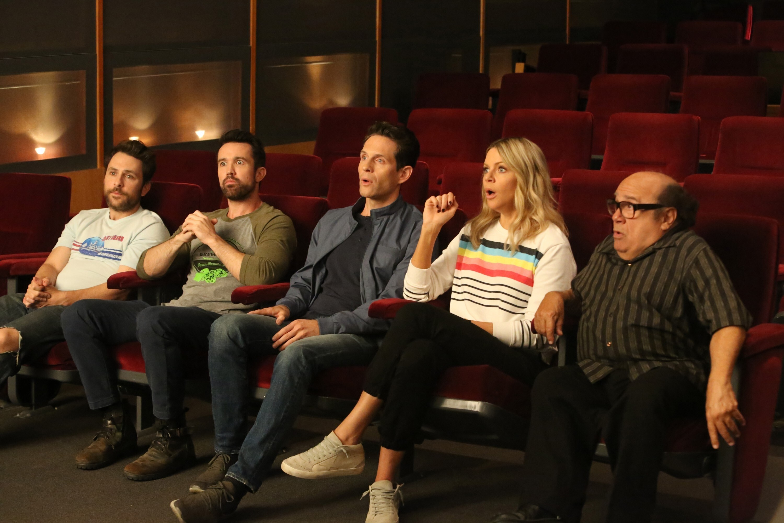 Charlie Day, Rob McElhenney, Glenn Howerton, Kaitlin Olson, and Danny DeVito sit in a theater