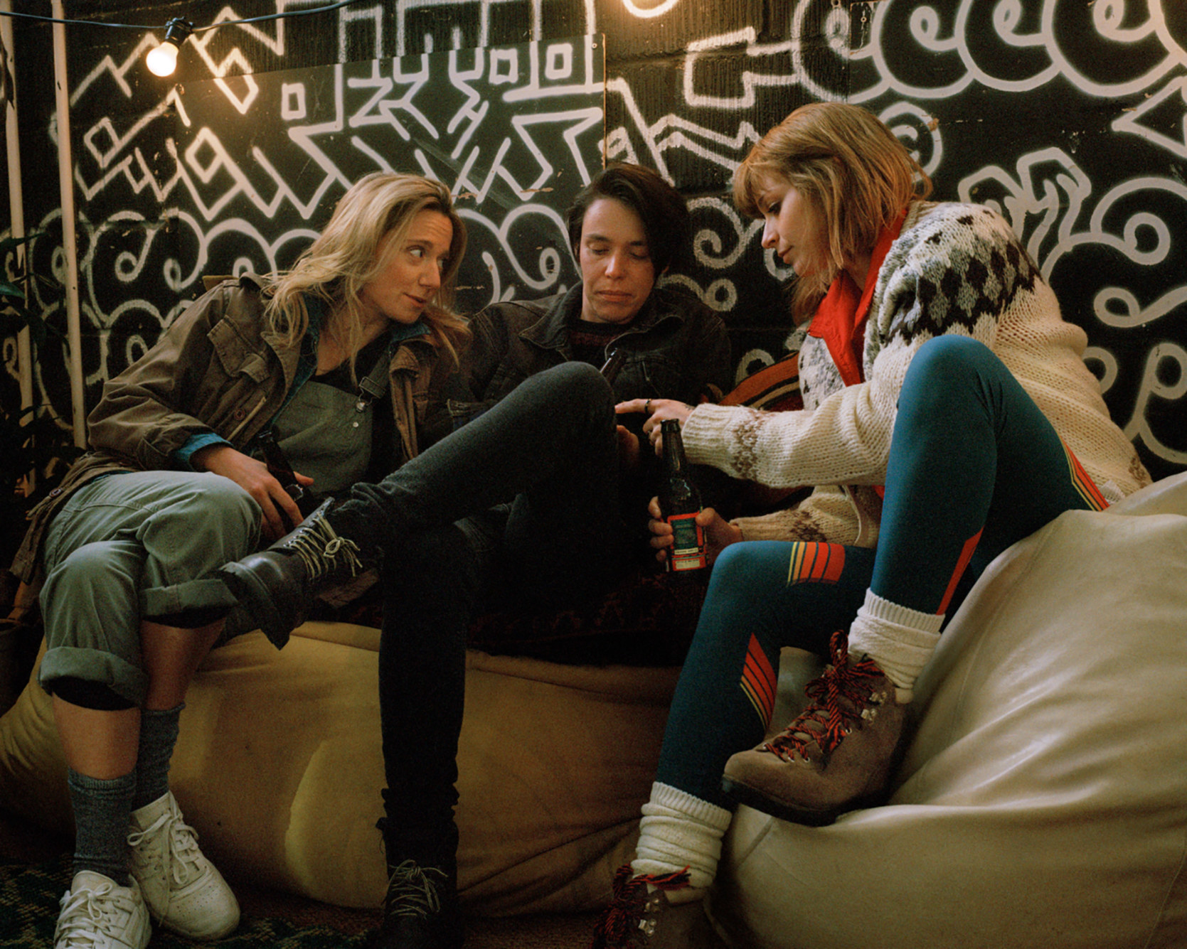 Hannah Almond, Caolihionn Dunne, and Niamh Algar sit on the couch