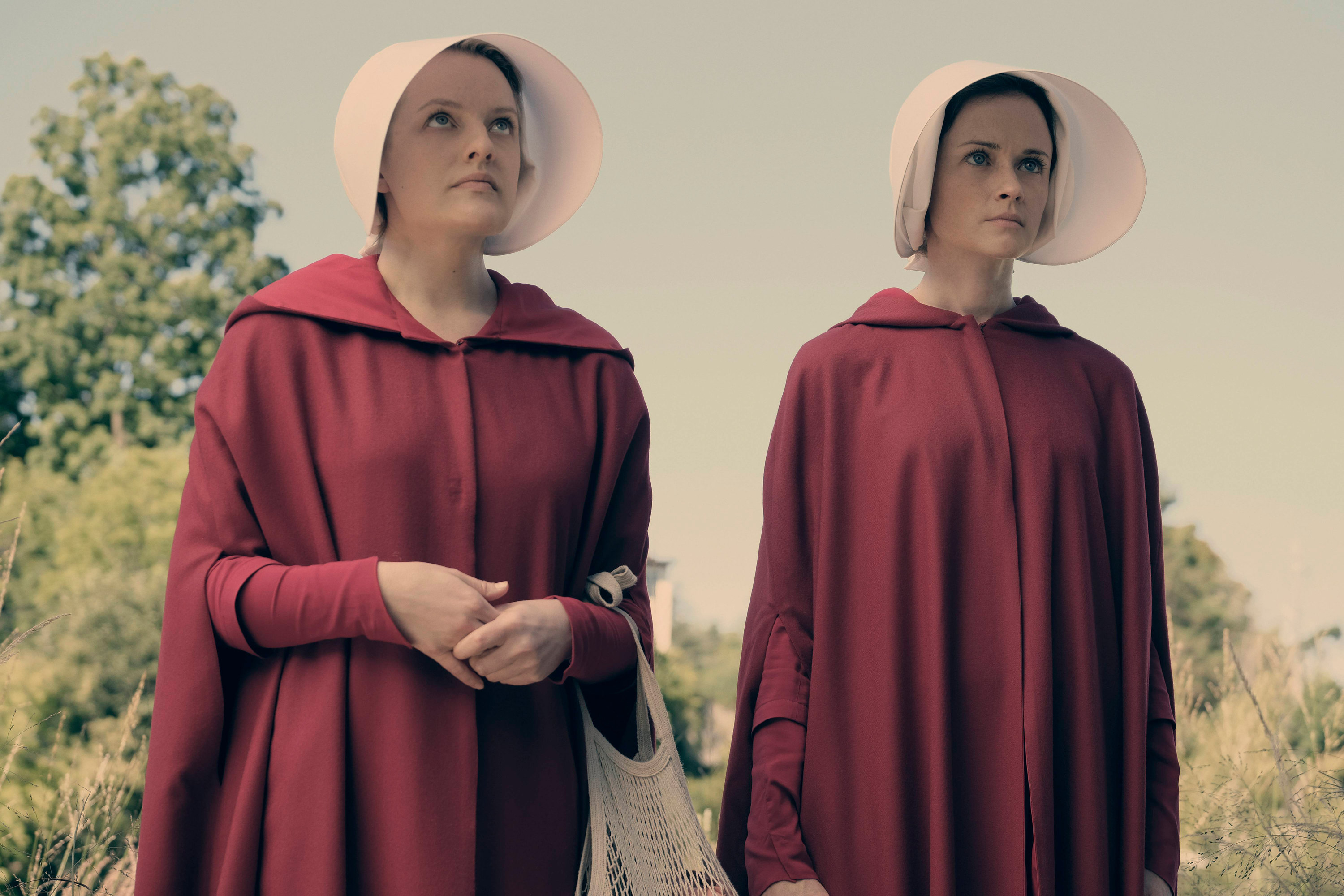 Elisabeth Moss and Alexis Bledel in red cloaks