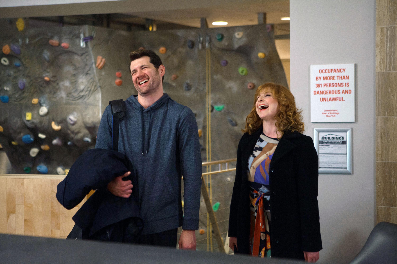 Billy Eichner and Julie Klausner laugh at a rock climbing gym