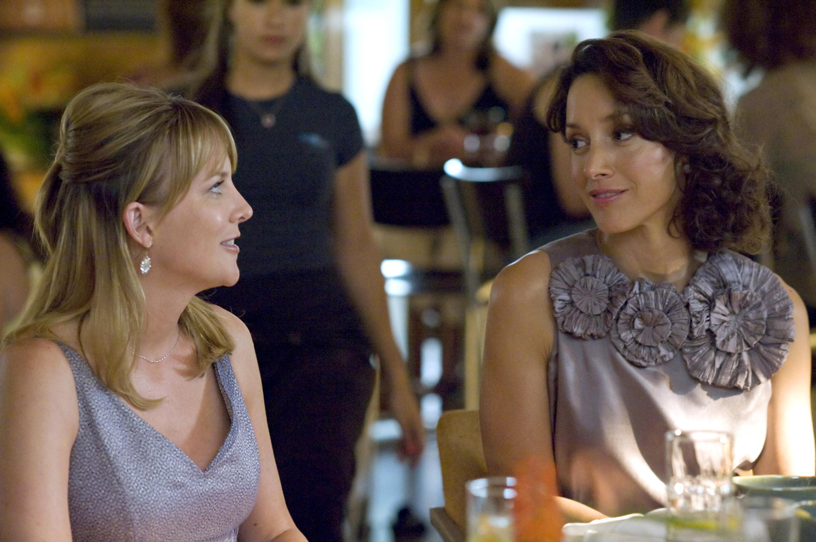 Laurel Holloman and Jennifer Beals sit at a table