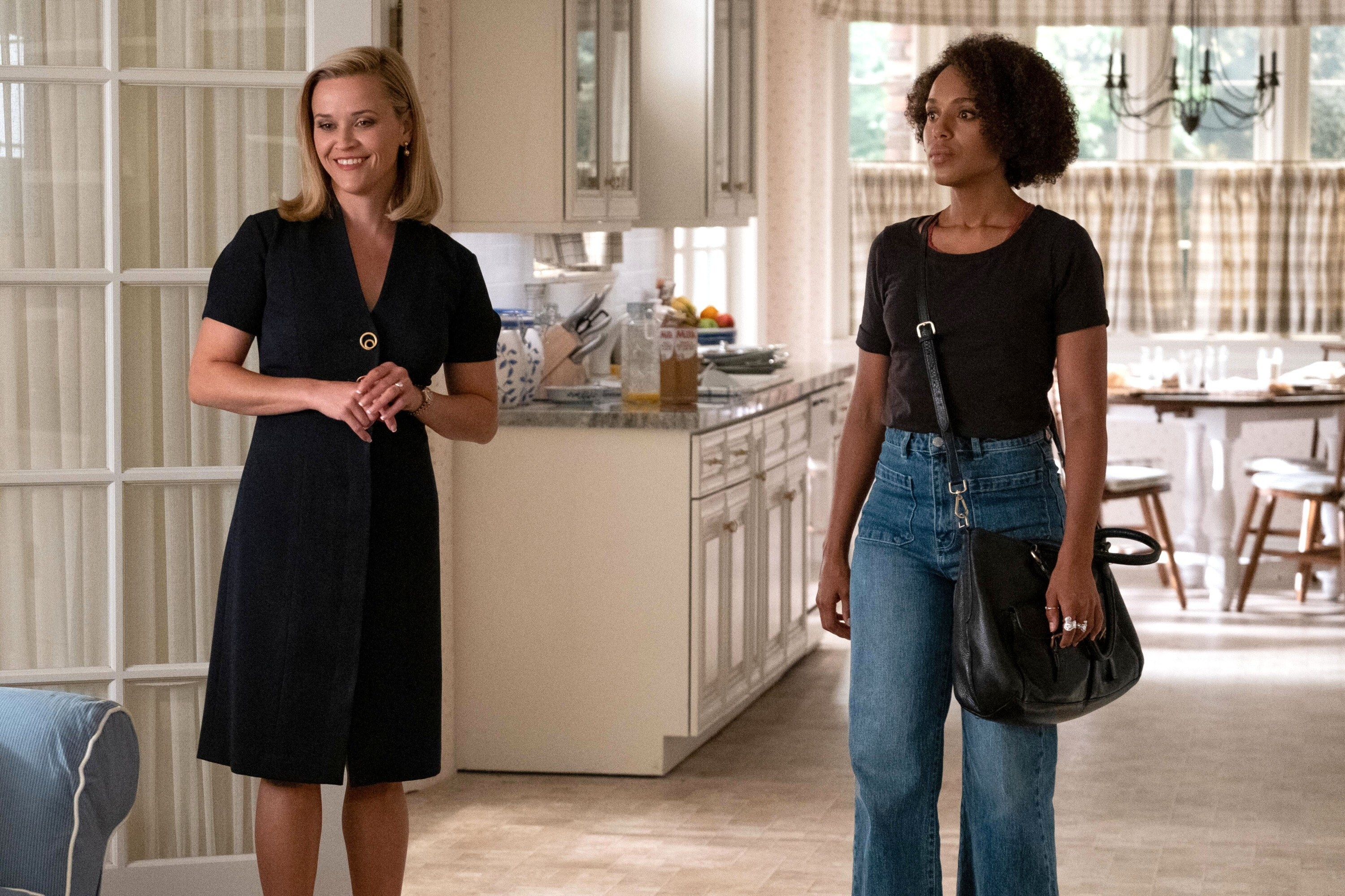 Reese Witherspoon and Kerry Washington stand in a kitchen