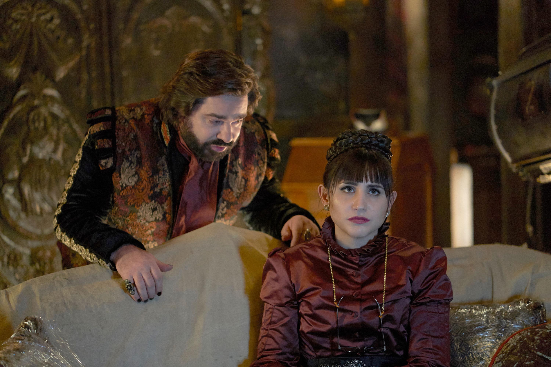 Matt Berry and Natasia Demetriou sit in their mansion