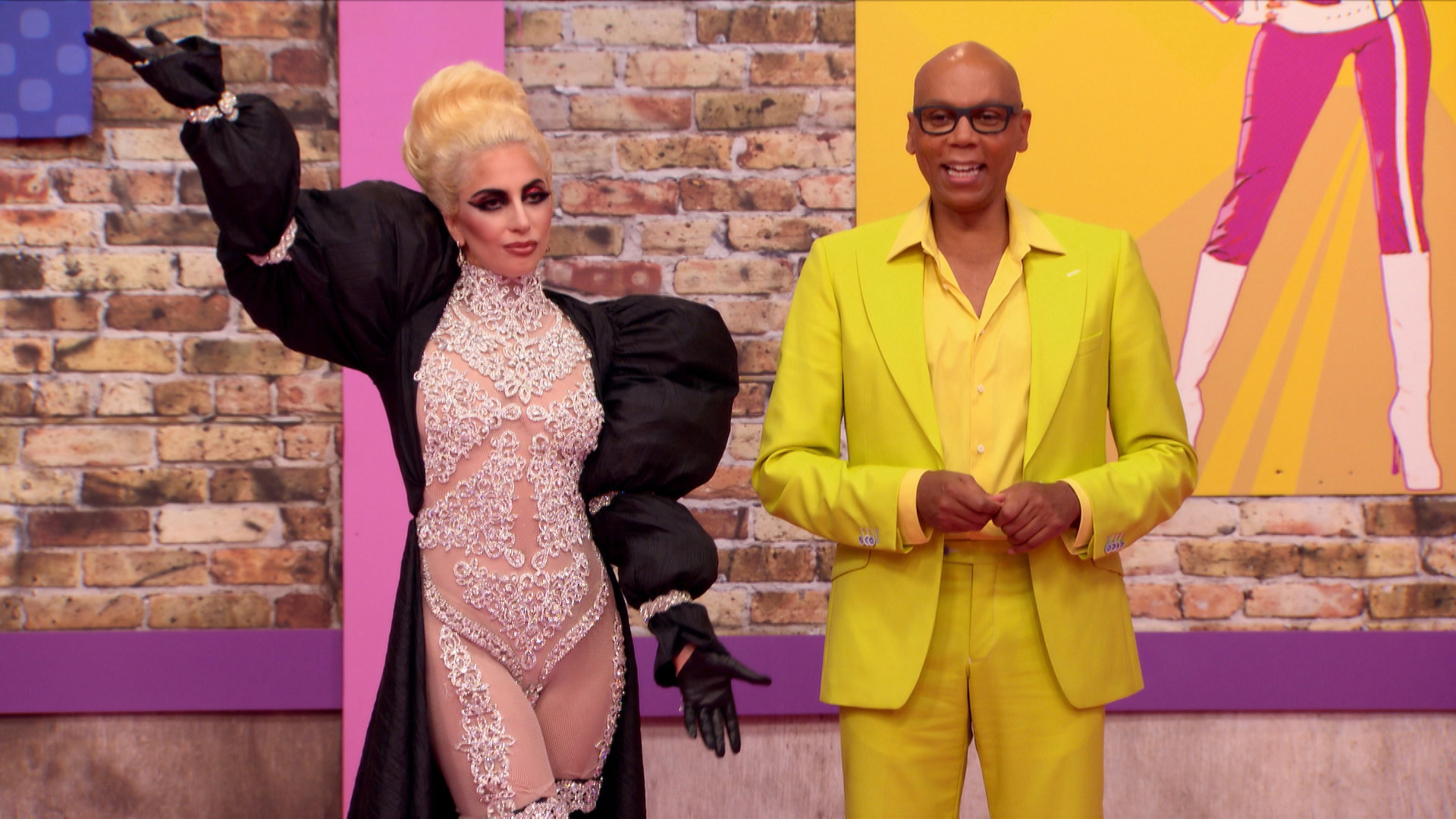 Lady Gaga and RuPaul stand in the work room