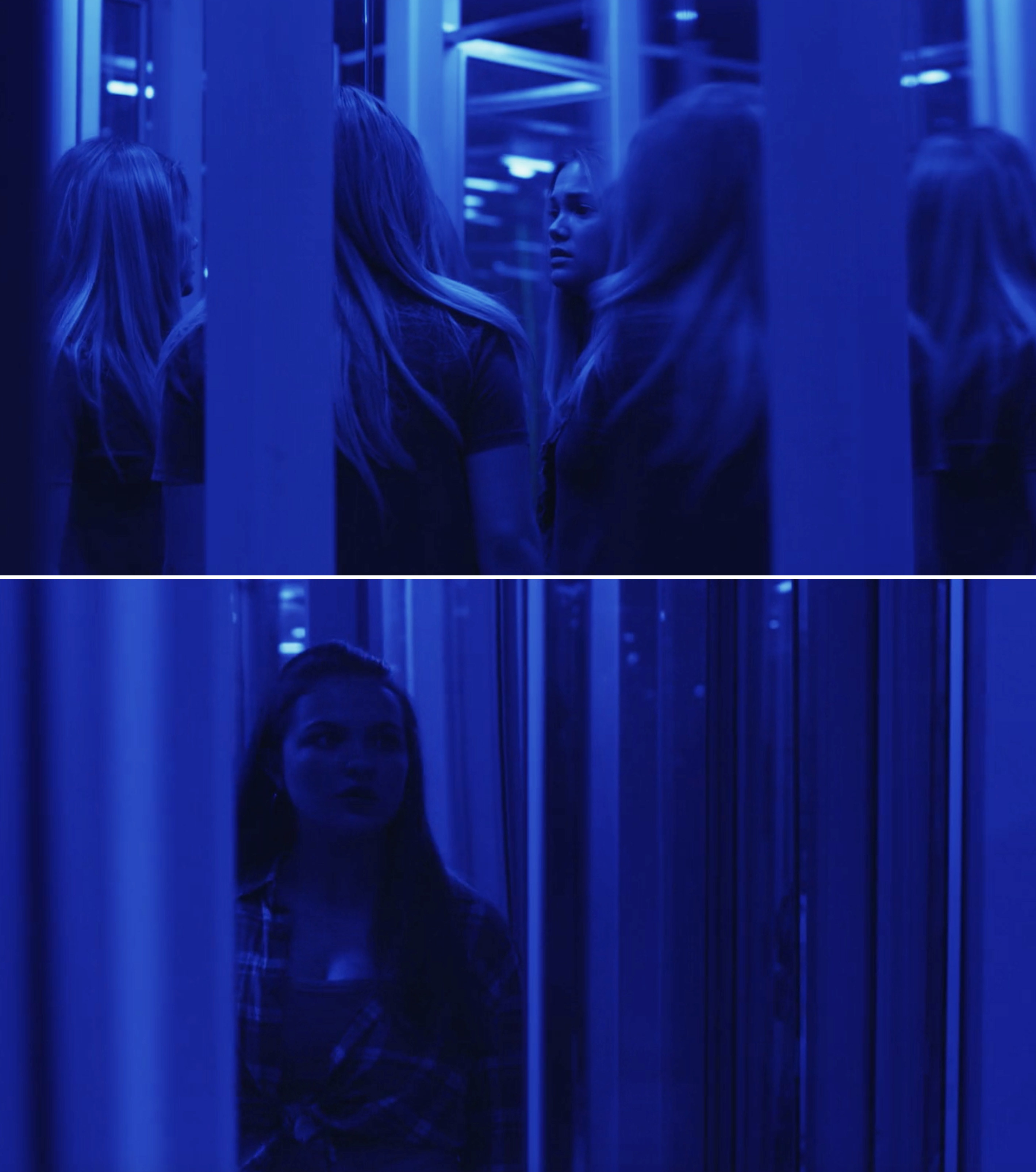 Beth and Jeanette walking through a funhouse with mirrors