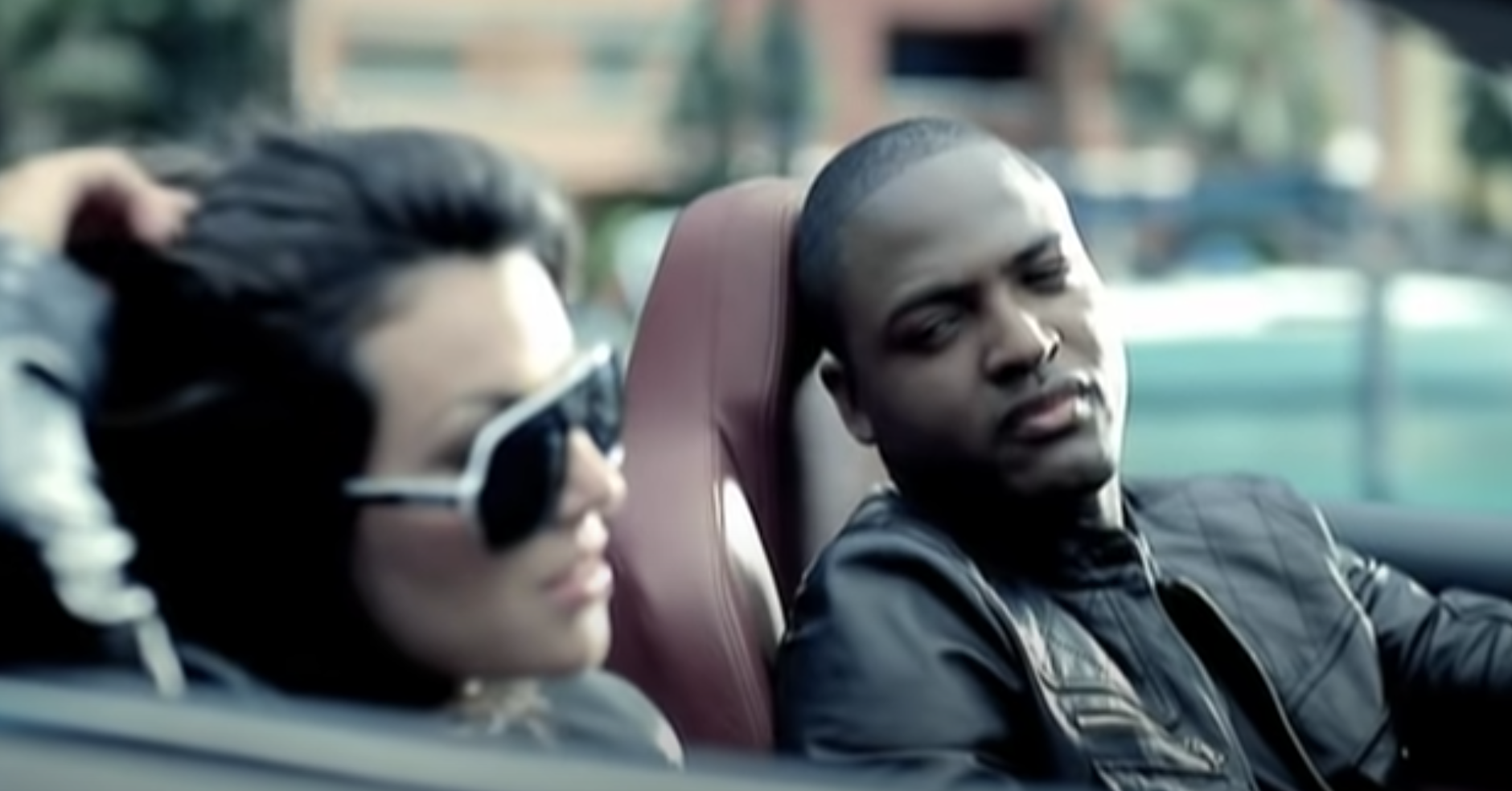 """Taio Cruz looks at his love interest in the video for """"Break Your Heart"""""""