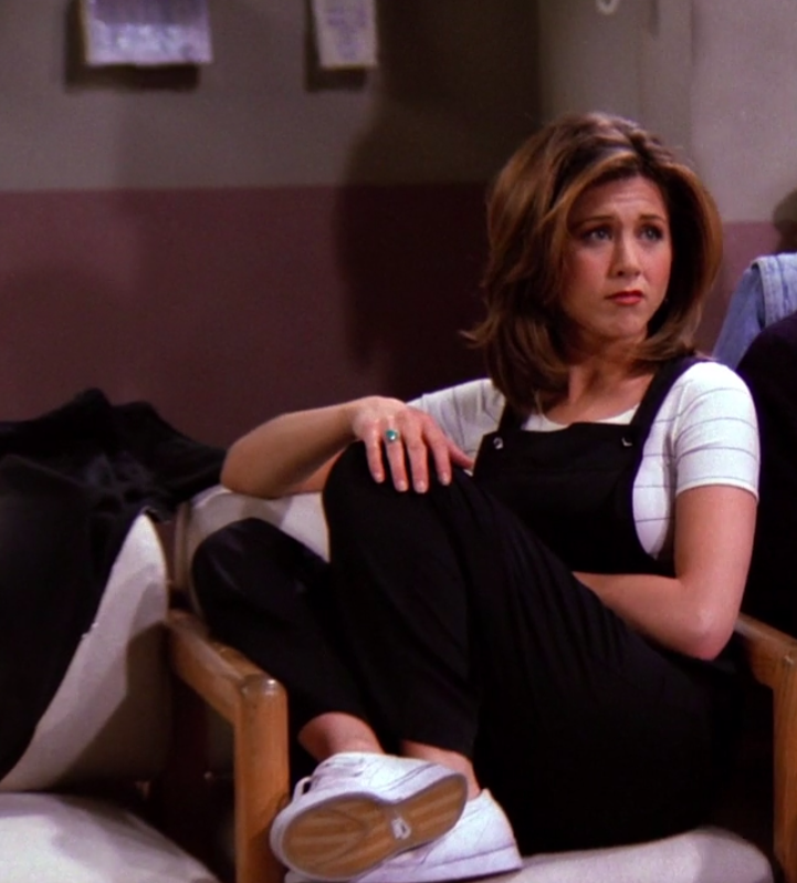 Rachel wearing a T-shirt, overalls, and sneakers