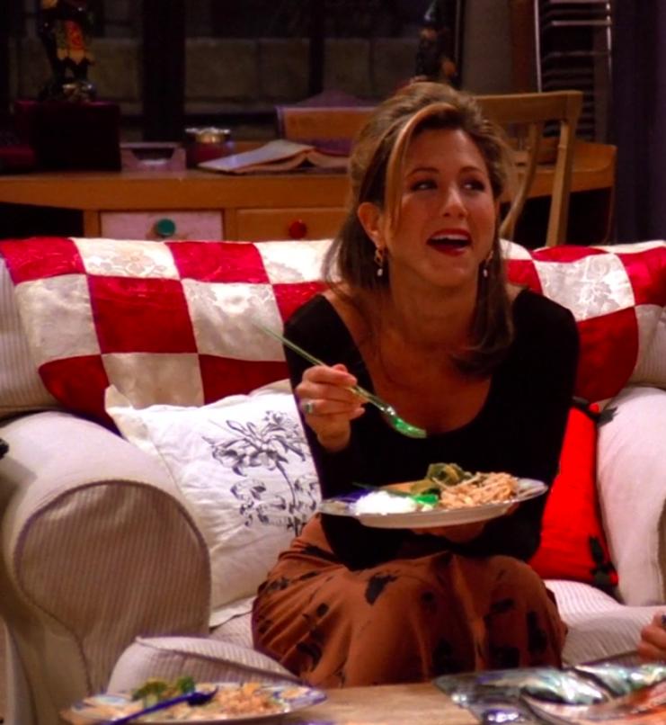 Rachel wearing a long-sleeve shirt and a maxi skirt