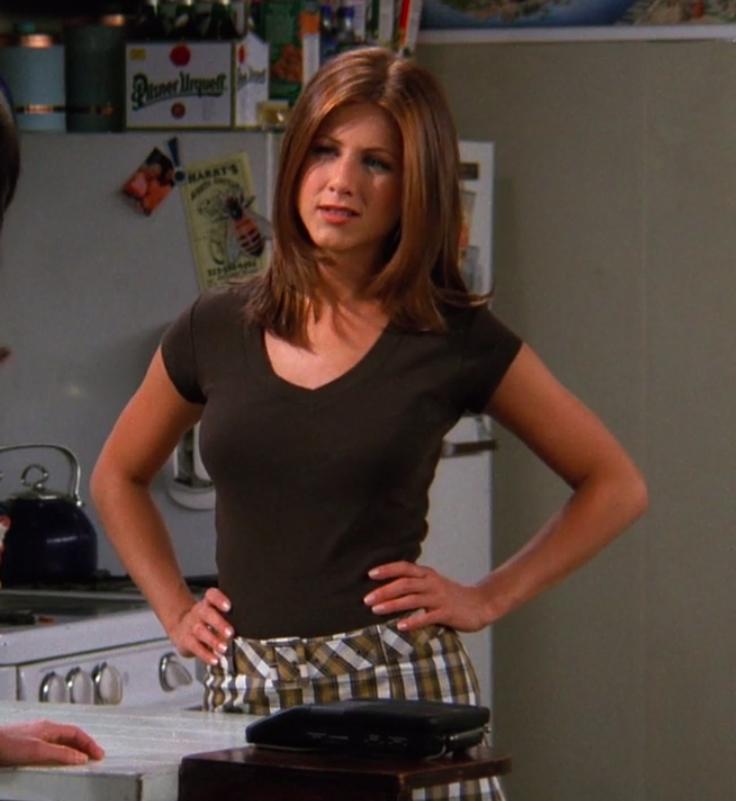 Rachel wearing, tights, a miniskirt, and a basic T-shirt