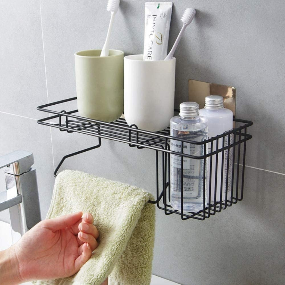 A caddy with shower products and a towel