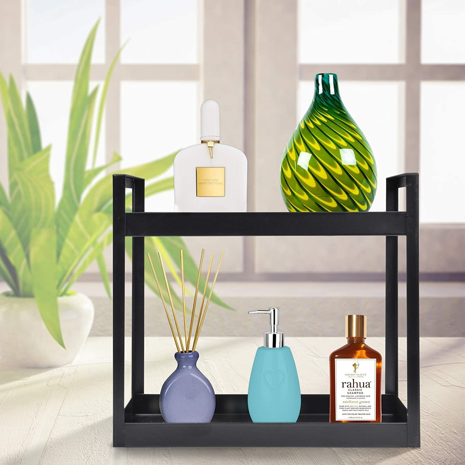 A black, metal two-tier shelf with items on it