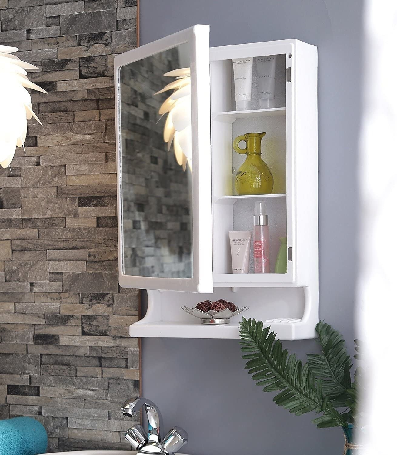 A mirror cabinet with items in it
