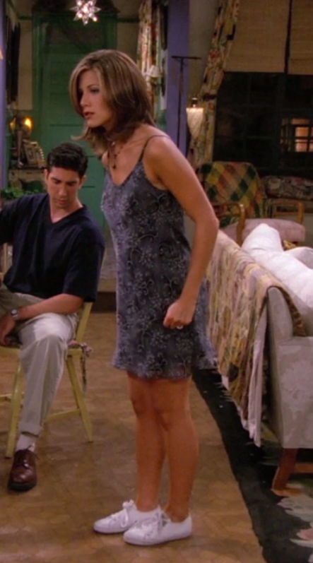 Rachel wearing a loose, tank minidress and sneakers