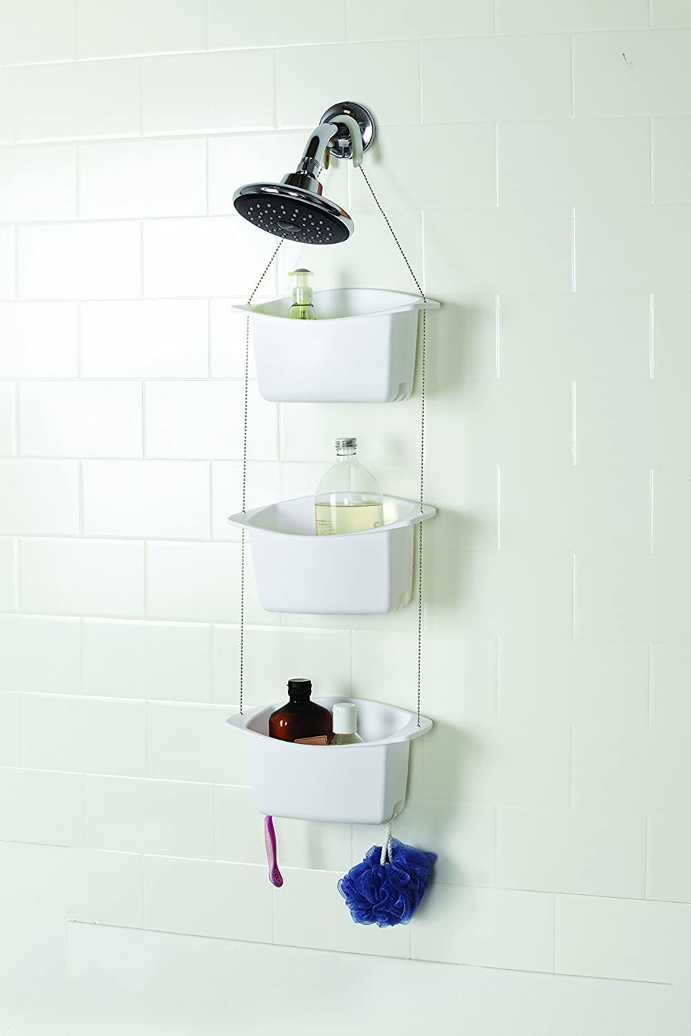 A three-layer shower caddy hanging from a showerhead.