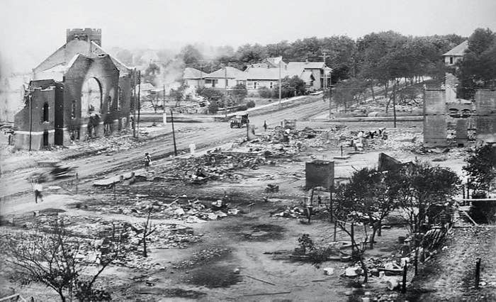A historical image of a devastated neighborhood, showing piles of rubble and debris