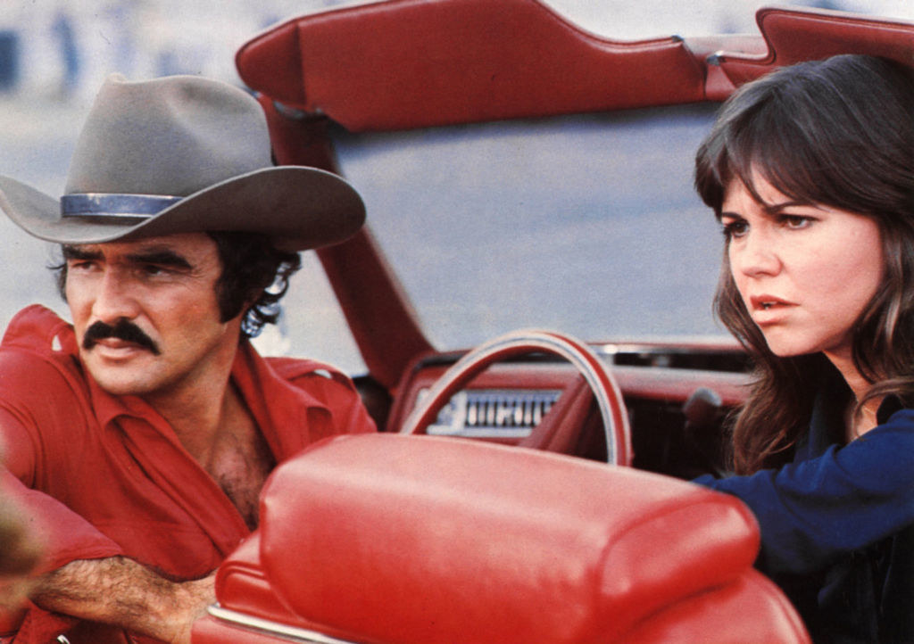 Sally and Burt in a car during one of their film scenes