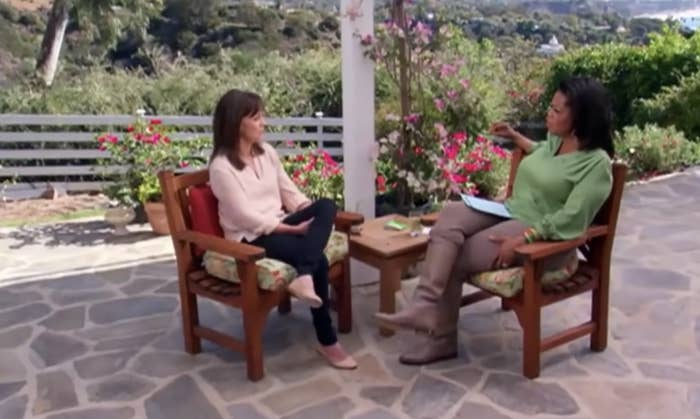 Oprah and Sally sitting on a patio for the interview