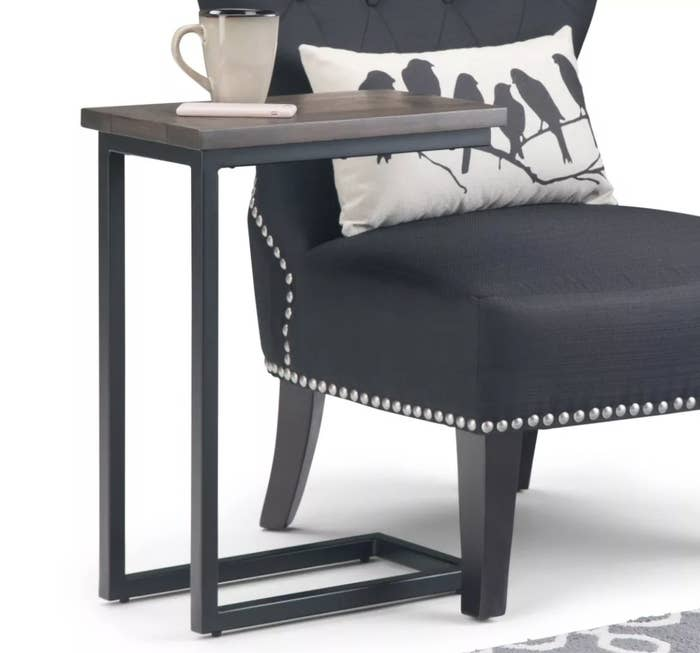 A C-shaped end table with metal frame and wood top