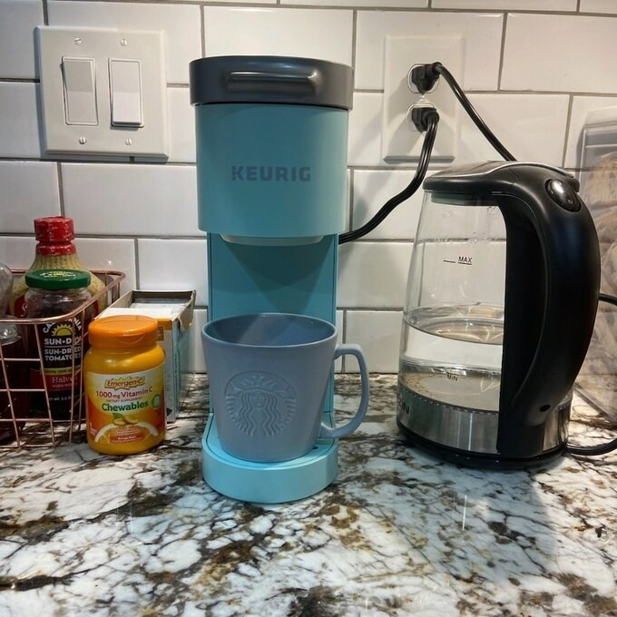 the Keurig in blue on a reviewer's counter