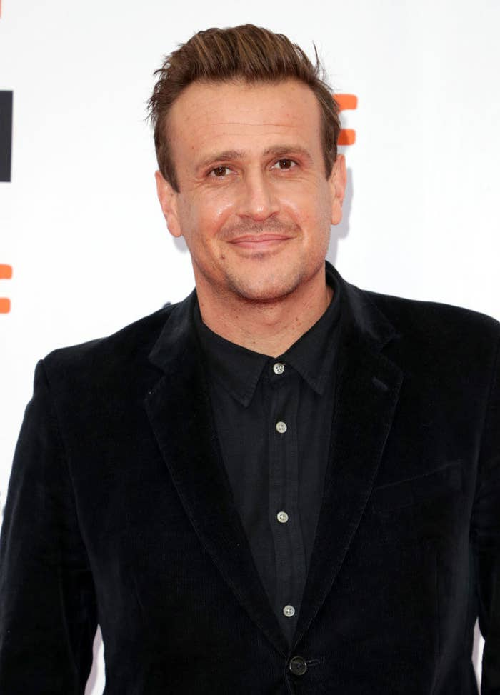 Jason Segel on the red carpet without a tie