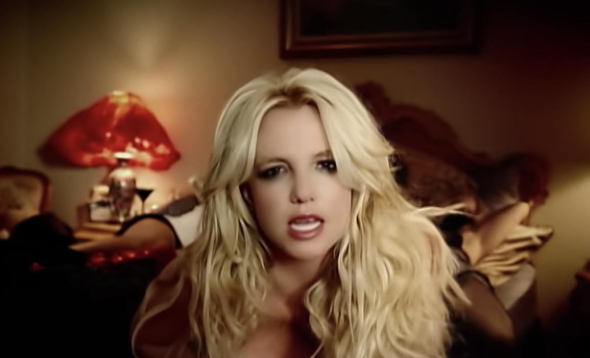 Britney singing in a hotel room