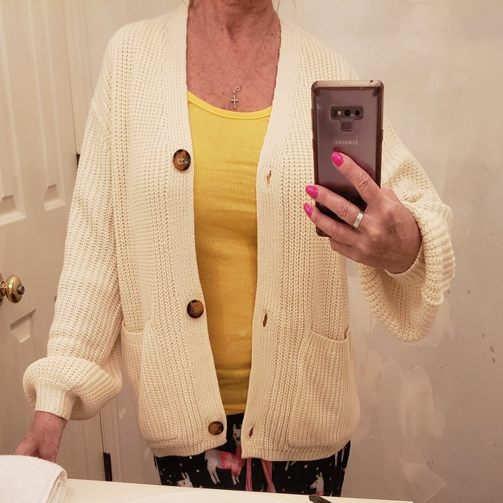 reviewer wearing cream cardigan unbuttoned
