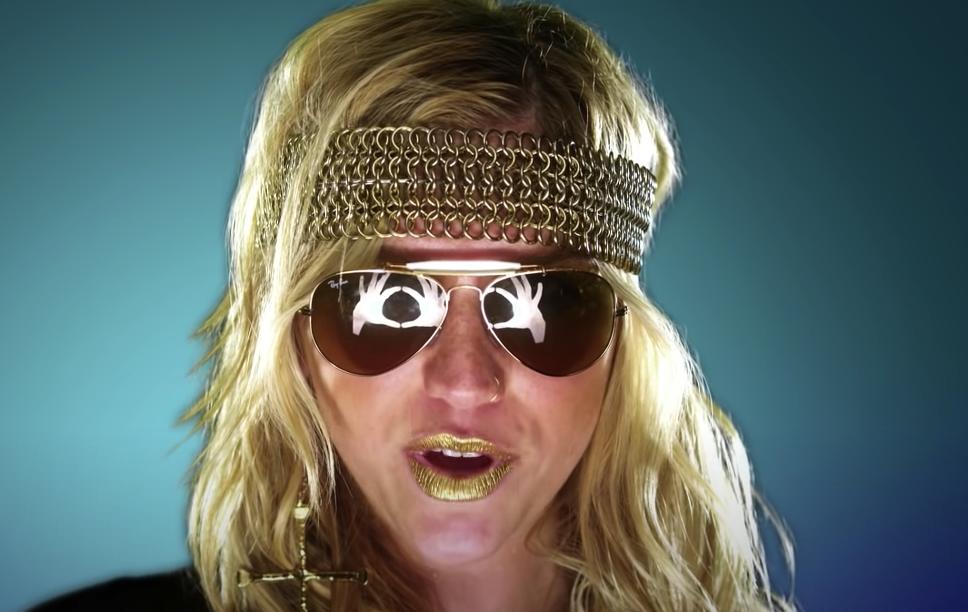 Kesha with sunglasses singing